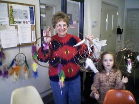 Director, Eloise Kuhn displays some dream catchers made at a Syracuse-Wawasee Historical Museum function